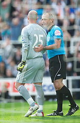 NEWCASTLE-UPON-TYNE, ENGLAND - Sunday, April 1, 2012: Liverpool's goalkeeper Jose Reina is shown the red card by referee Martin Atkinson and sent off against Newcastle United during the Premiership match at St James' Park. (Pic by David Rawcliffe/Propaganda)
