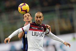 February 3, 2019 - Milan, Milan, Italy - Cedric Soares #21 of FC Internazionale Milano competes for the ball with Rodrigo Palacio #24 of Bologna FC during the serie A match between FC Internazionale and Bologna FC at Stadio Giuseppe Meazza on February 3, 2019 in Milan, Italy. (Credit Image: © Giuseppe Cottini/NurPhoto via ZUMA Press)