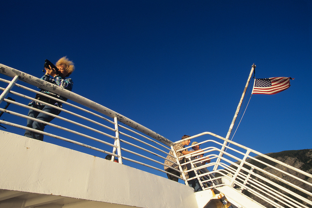 USA, Alaska, Passengers on Alaska State Ferry sails up Lynn Canal toward town of Haines along Inside Passage