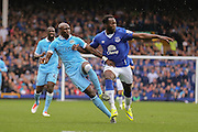 forward Romelu Lukaku battles with defender Eliaquim Mangala during the Barclays Premier League match between Everton and Manchester City at Goodison Park, Liverpool, England on 23 August 2015. Photo by Simon Davies.