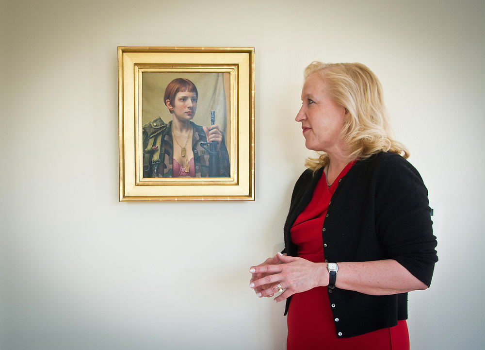 "mkb041217a/metro/Marla Brose --  Albuquerque lawyer Randi McGinn looks at ""Sweet M-16"" by Will Wilson, one of the many female empowerment paintings in her office at McGinn Carpenter Montoya & Love, a law firm that McGinn, who has been practicing law since 1980, founded. McGinn was the special prosecutor in the State of N.M. vs. Keith Sandy and Dominique Perez. (Marla Brose/Albuquerque Journal)"