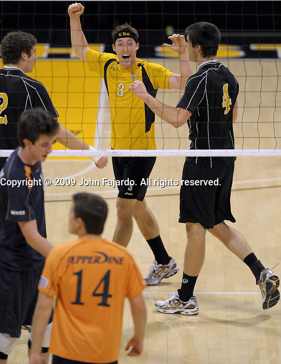 Dustin Watten celebrates the point in the Mountain Pacific Sports Federation match against Pepperdine at the Walter Pyramid, Long Beach CA, Friday March 6, 2009.  The 49ers lose the match in five sets 30-21, 30-24, 32-30, 26-15, 12-15.