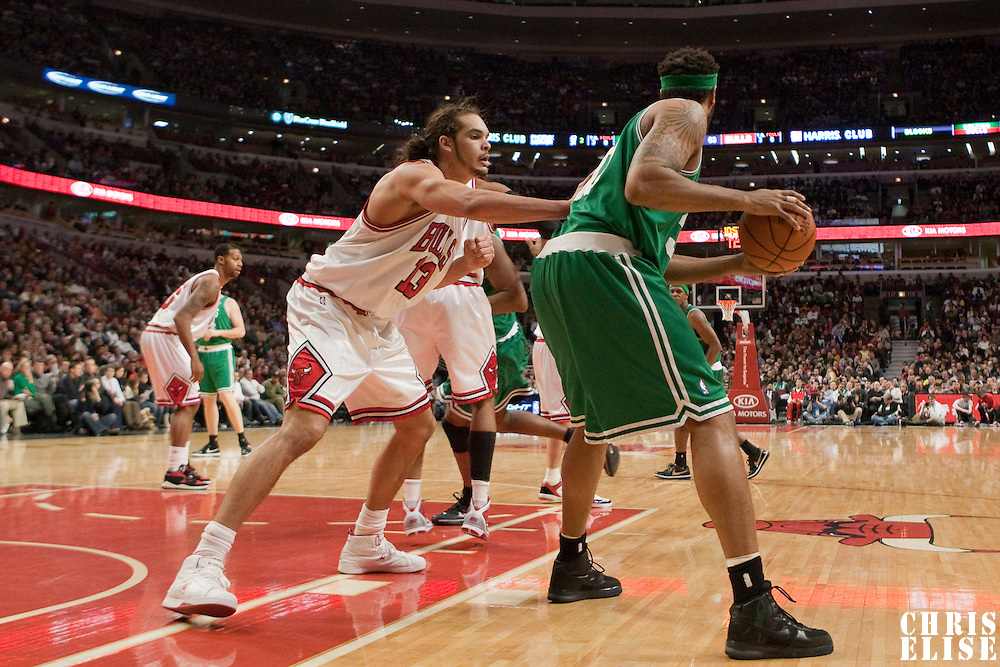 12 December 2009: Chicago Bulls center Joakim Noah defends against Boston Celtics center Rasheed Wallace during the Boston Celtics 106-80 win over the Chicago Bulls at the United Center, in Chicago, Illinois, USA.