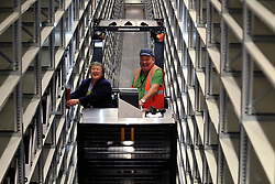 © London News Pictures. 2011/01/14 . Dr Sarah Thomas, Bodley's Librarian places the one millionth book on the shelf. The Bodleian Book Storage Facility (BSF) in Swindon, UK,  'ingests' its one millionth item, the book 'Journal of General Physiology Volume 1 1918-1919' on Friday, 14 January 2011. It has been achieved in just under three months and has required an average daily ingest rate of 19,000 books and periodicals per day by 32 staff. On peak days, and depending on the materials, as many as 42,000 items have been ingested. . Picture credit should read Stephen Simpson/LNP