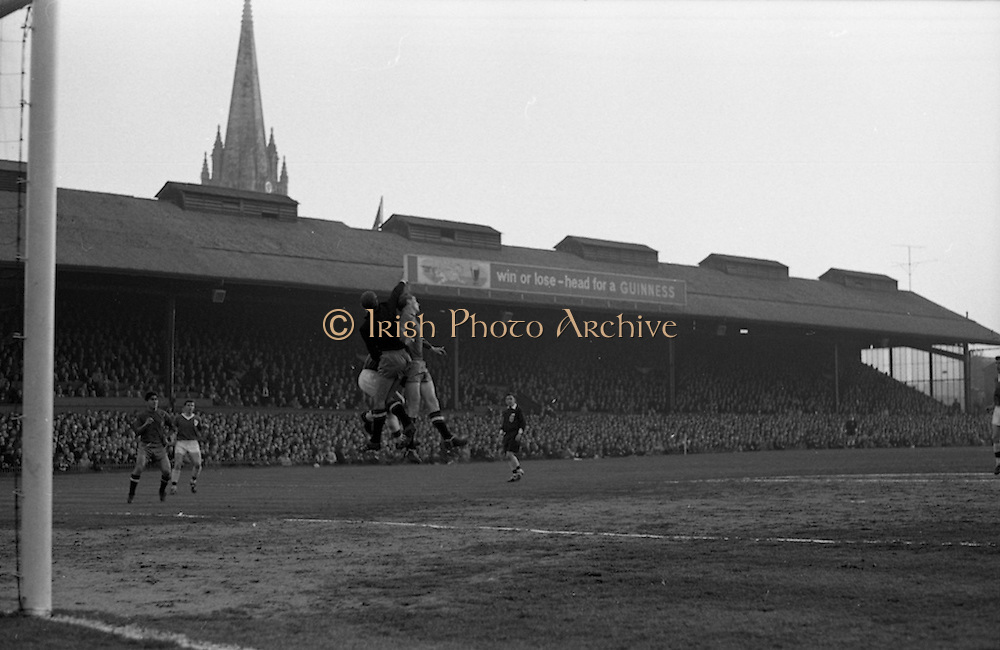 05/05/1965<br /> 05/05/1965<br /> 05 May 1965<br /> Ireland v Spain, World Cup Qualifier at Dalymount Park, Dublin. Spanish keeper saveswith Olivella (5) in support while Ireland's Noel Cantwell (9) closes in.