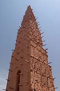 Minaret of a Sudanese-style mud-brick mosque in Bani, Northeastern Burkina Faso, West Africa.
