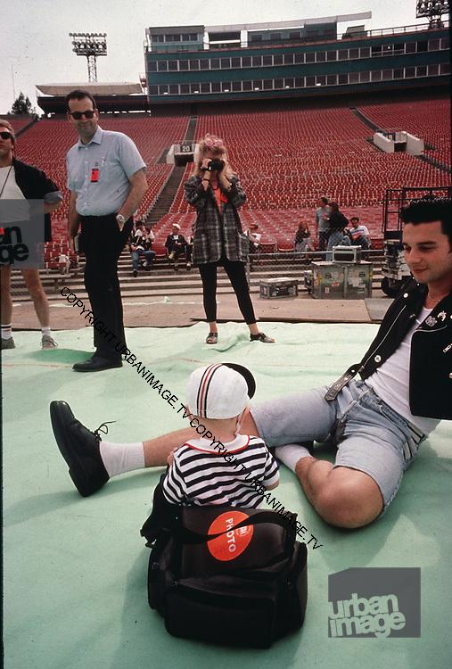 David Gahan and a toddler of Depeche Mode, photographed at Pasadena Rose Bowl, June 1988.