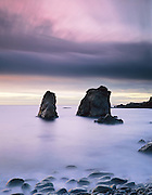 Rock formations and twilight surf, Garapatta State Beach, Big Sur, California