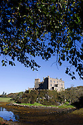 Built on rocks once surrounded by sea, Dunvegan Castle is home to Hugh MacLeod, Chief of the ancient clan MacLeod on the north-west corner of the Isle of Skye, Scottish Highlands. Hugh is the 30th encumbent of the McLeods and this has been the clan's traditional stronghold and ancestral home for 800 years which makes it the longest inhabited family home in Scotland. Now a visitor centre and place of pilgrimage for MacLeods from all over the world, it houses medieval artefacts from when Scotland was a wild and warring nation against the English. It has survived clan battles, extremes of feast and famine and profound social, political and economic changes in the Highlands. Originally designed to keep people out, Dunvegan Castle was first opened to the public in 1933. Visitors include Sir Walter Scott, Dr Johnson, Queen Elizabeth II and Emperor Akihito.