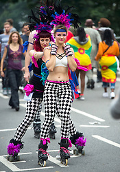 © Licensed to London News Pictures. 30/08/2015. London, UK. A group of roller skaters in carnival dress take part in Family day at the Notting Hill Carnival in West London. The annual event, dating back to 1966, is one of the world's largest street festivals, attracting over one million people. Photo credit: Ben Cawthra/LNP