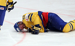 Stockholm 11-05-2012 Icehockey, Icehockey World Championchips 2012 Russia-Sweden:: a high stick from Russia 7 Dmitri Kalinin (SKA St Petersburg) hit Sverige Sweden 93 Johan Franzen in the face and blood poured on the icebold Blood skada, skadan , ont , smärta , pain , injury , injuries // during the IIHF Icehockey World Championship Game between Russia (RUS) and Sweden (SWE) at the Ericsson Globe, Stockholm, Sweden on 2012/05/11. EXPA Pictures © 2012, PhotoCredit: EXPA/ PicAgency Skycam/ Morten Christensen..***** ATTENTION - OUT OF SWE *****