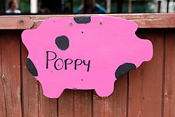 © Licensed to London News Pictures.14/07/15<br /> Harrogate, UK. <br /> <br /> A sign fastened to the gate on one of the pig pens on the opening day of the Great Yorkshire Show.  <br /> <br /> England's premier agricultural show opened it's gates today for the start of three days of showcasing the best in British farming and the countryside.<br /> <br /> The event, which attracts over 130,000 visitors each year displays the cream of the country's livestock and offers numerous displays and events giving the chance for visitors to see many different countryside activities.<br /> <br /> Photo credit : Ian Forsyth/LNP