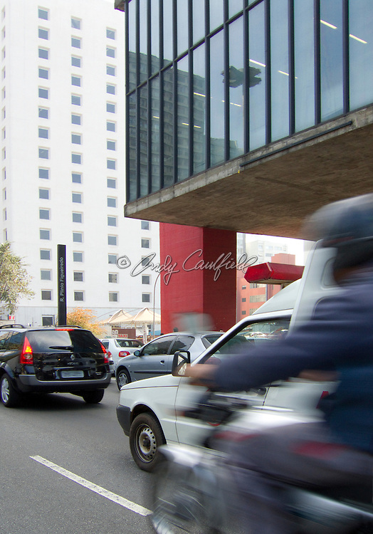 Auto and Motorcycle traffic on Paulista Ave. in front of MASP building, Sao Paulo, Brazil.