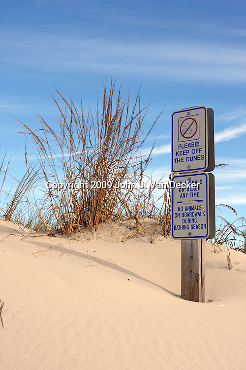 Warning Sign to keep off beach sand dunes