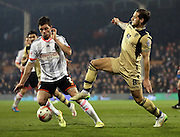 Billy Sharp tackling Tim Hoogland during the Sky Bet Championship match between Fulham and Leeds United at Craven Cottage, London, England on 18 March 2015. Photo by Matthew Redman.