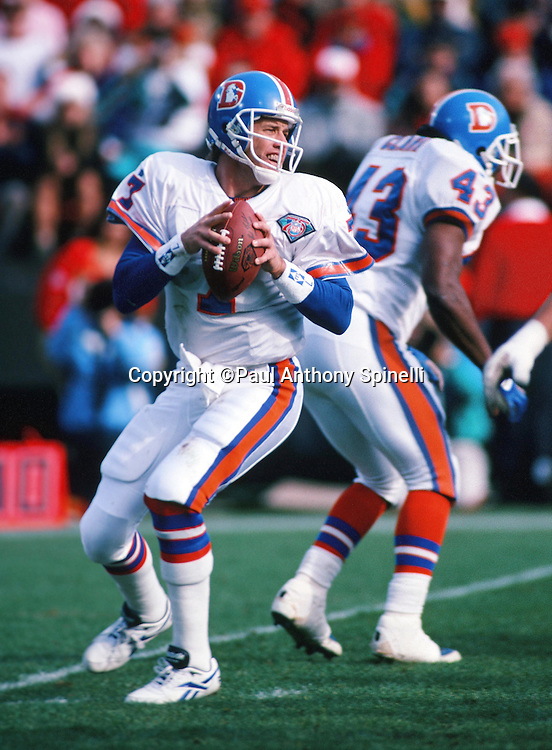 Denver Broncos quarterback John Elway (7) throws a pass during the NFL football game against the San Francisco 49ers on Dec. 17, 1994 in San Francisco. The 49ers won the game 42-19. (©Paul Anthony Spinelli)