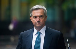 ©  London News Pictures. 01/10/2012. London, UK. Liberal Democrat MP CHRIS HUHNE returning to Southwark Crown Court after lunch break on October 1, 2012 where he faces charges of perverting the course of justice. The trial of Former Energy Secretary CHRIS HUHNE and his ex-wife VICKY PRYCE is due to start tomorrow (Tues). HUHNE is accused of asking his ex-wife VICKY PRYCE to take speeding points on his behalf in 2003. Photo credit : Ben Cawthra/LNP