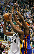 Utah Jazz forward C.J. Miles (34) attempts to score against New York Knicks guard Bill Walker (5) during the second half of an NBA basketball game in Salt Lake City, Wednesday Jan. 12, 2011. Miles scored 24 points in the Jazz' 131-125 win. (AP Photo/Colin E Braley)