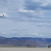 A break in the action allows a Delta 757 take off as some vintage aircraft come back - A B-25 Mitchell and a Lockheed T-33 (based on the P-80 Shooting Star).