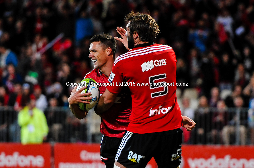 Dan Carter of the Crusaders celebrates try with Sam Whitelock of the Crusaders during the Super Rugby match, Crusaders v Cheetahs, 21 March 2015 at AMI Stadium, Christchurch. Copyright Photo: John Davidson / www.Photosport.co.nz