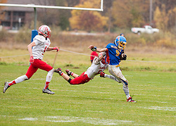 Laconia freshman Caleb Roy grabs Gilford junior Dylan Gansert on Saturday, October 29, 2016.  (Alan MacRae/for the Laconia Daily Sun)