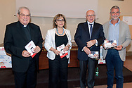ROME, ITALY - JUNE 26: Monsignor Enrico Feroci, director of Caritas of Rome, Elisa Manna, Head of the Caritas Study Centre of Rome, prof. Alberto Ugazio director of the Child Jesus Institute for Child and Adolescent Health, Stefano Vicari Head of the Operative Unit Complex of Child Neuropsychiatry of the Child Child Child Pediatric Hospital of Rome  during the press conference to present a survey conducted by Caritas of Rome on a sample of 1,600 young people regarding the knowledge and consumption of gambling on June 26, 2018 in Rome, Italy.