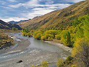 Autumn view looking upstream on the Shotover River and Skippers Canyon, near Queenstown, Otago, New Zealand.