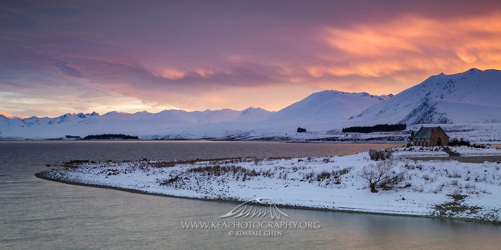 At the edge of snow-clad Lake Tekapo, the Church of the Good Shepherd waits quietly as a winter sunrise unfurls its magic.