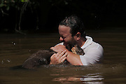Graham Watkins & Giant Otter (Pteronura brasiliensis) HABITUATED. Karanambu Otter Trust for re-introduction<br /> Savannah<br /> Rupununi<br /> GUYANA. South America<br /> RANGE: Orinoco, Amazon, and Guianas river systems<br /> IUCN: ENDANGERED SPECIES