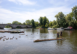 © Licensed to London News Pictures. 02/06/2020. London, UK. Two men out in the sunshine on the Thames at Richmond in South West London as weather experts predict another warm day with highs of 26c. Tomorrow a cold front with rain will hit the South East. On Monday, up to six people are now allowed to meet up in parks and private gardens. Photo credit: Alex Lentati/LNP