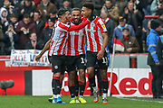 "GOAL 3-0 Brentford forward Ollie Watkins (11) scores and celebrates<br /> Brentford's ""BMW"" of Benrahma, Mbeumo and Watkins, during the EFL Sky Bet Championship match between Brentford and Queens Park Rangers at Griffin Park, London, England on 11 January 2020."