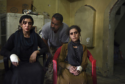 July 13, 2017 - Mosul, Iraq - Four Yazidi civilians said they escaped being held captive by ISIS for four years Iraqi Army soldiers advanced in the old city. The women said they were used as sex slaves. The battle with ISIS continues in a small part of West Mosul even though it was declared liberated days ago. Injuries from suicide bombers, grenades and snipers continue as ISIS fighters use tunnels to continue the fierce conflict. (Credit Image: © Carol Guzy via ZUMA Wire)