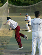 Ahsan Ali, from Centerville (left) pitches to Ahmed Butt as Naveed Haq looks on during a practice of the Greater Dayton Cricket Club at Stubbs Park in Centerville, Thursday, June, 21st.