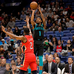 Apr 3, 2019; New Orleans, LA, USA;  Charlotte Hornets guard Malik Monk (1) shoots over New Orleans Pelicans guard Ian Clark (2) during the first quarter at the Smoothie King Center. Mandatory Credit: Derick E. Hingle-USA TODAY Sports