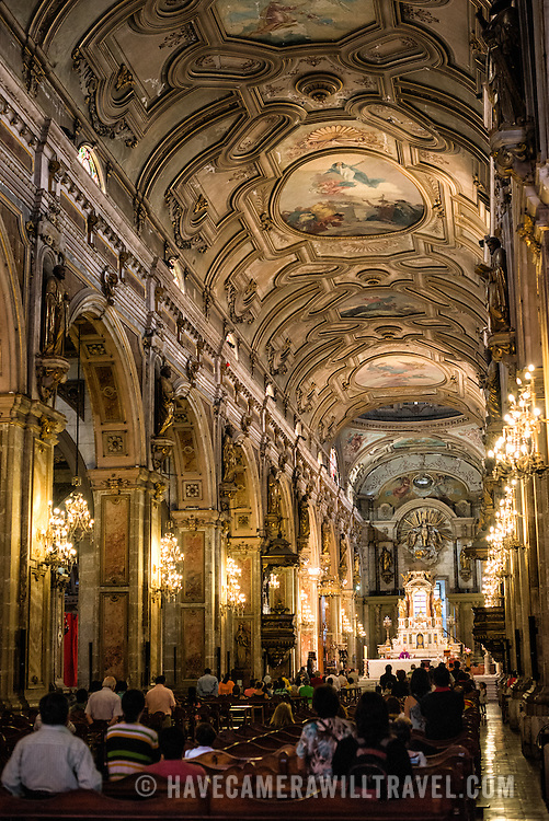 The richly decorated nave of the Metropolitan Cathedral of Santiago (Catedral Metropolitana de Santiago) in the heart of Santiago, Chile, facing Plaza de Armas. The original cathedral was constructed during the period 1748 to 1800 (with subsequent alterations) of a neoclassical design.