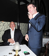 09.FEB.2009 - LONDON<br /> <br /> SIMON COWELL AND PHILLIP GREEN SIT OUTSIDE SCOTTS RESTAURANT MAYFAIR TO HAVE A MID DINNER CIGARETTE BEFORE LEAVING TOGETHER.<br /> <br /> BYLINE MUST READ : EDBIMAGEARCHIVE.COM<br /> <br /> *THIS IMAGE IS STRICTLY FOR UK NEWSPAPERS &amp; MAGAZINES ONLY*<br /> *FOR WORLDWIDE SALES &amp; WEB USE PLEASE CONTACT EDBIMAGEARCHIVE-0208 954 5968*