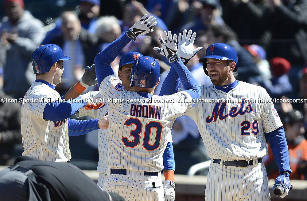 March 31, 2014 - New York, NY, USA - New York Mets' David Wright, Juan Lagares and Ike Davis congratulate Andrew Brown, who hit a three-run homer against the Washington Nationals, during the first inning on Opening Day at Citi Field in New York on Monday, March 31, 2014