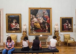 visitors looking at paintings in gallery at Capitolini Museums in Rome Italy