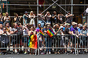 New York, NY - 30 June 2019. The New York City Heritage of Pride March filled Fifth Avenue for hours with participants from the LGBTQ community and it's supporters. Spectors line 5th Avenue, some climbing into the scaffolding for a better view.