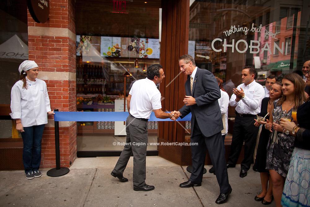 Lieutenant Governor Robert Duffy and Chobani CEO Hamdi Ulukaya at the ribbon cutting ceremony of Chobani Yogurt Bar in SoHo, New York.  .. Photo by Robert Caplin