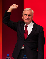 © Licensed to London News Pictures. 24/09/2018. Liverpool, UK. Shadow Chancellor John McDonnell MP raises his fist after delivering his speech at the Labour Party Conference 2018. Photo credit: Rob Pinney/LNP