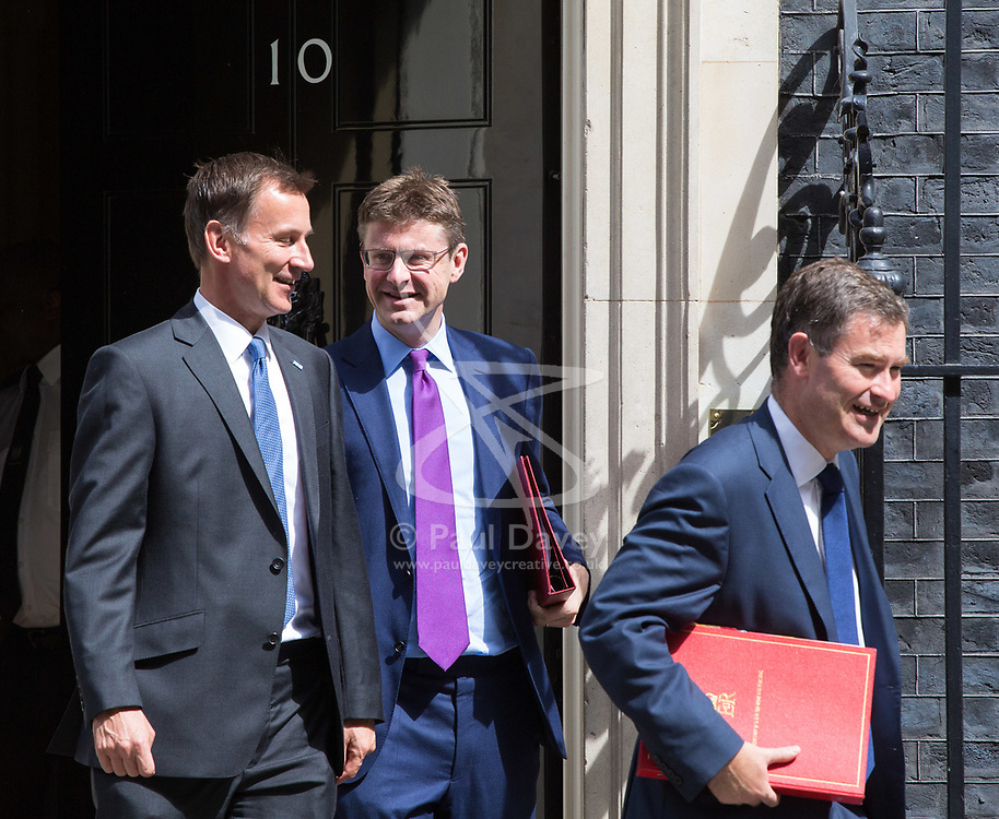 London, July 18th 2017. In a clear demonstration of unity with a cabinet that has seemed to be split over Brexit and other issues,  Government ministers, L-R Health Secretary Jeremy Hunt, Secretary of State for Business, Energy and Industrial Strategy Greg Clark and Secretary of State for Work and Pensions David Gauke leave the last cabinet meeting together before the Parliamentary summer recess at Downing Street in London.