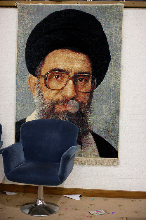 A larger-than-life portrait of incumbent supreme leader Ali Khamenei decorates the VVIP area at an election campaign event in Tehran's Azadi sport complex.