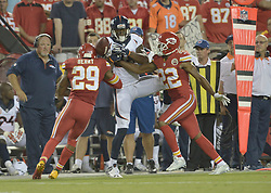 Sep 17, 2015; Kansas City, MO, USA; Denver Broncos wide receiver Demaryius Thomas (88) can't make the catch as the pass is broken up by Kansas City Chiefs strong safety Eric Berry (29) and cornerback Marcus Peters (22) during the second half at Arrowhead Stadium. The Broncos won 31-24. Mandatory Credit: Denny Medley-USA TODAY Sports