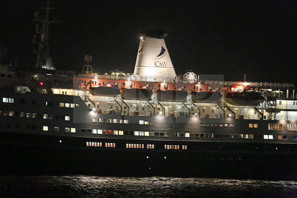 © Licensed to London News Pictures. 15/02/2014. The cruise ship Marco Polo has returned to her home port a day after a passenger was killed by the extreme weather. She was in the English channel at the end of a 42 day cruise when a freak wave crashed against the ship, smashing windows in one of the onboard restaurants. As well as the death, another passenger was airlifted away for treatment and others were treated on board. She returned back to Tilbury ahead of schedule, reaching the port in Essex shortly before 10pm. Credit : Rob Powell/LNP