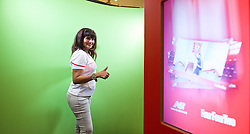 KUALA LUMPUR, MALAYSIA - Wednesday, July 22, 2015: A Liverpool supporter poses in front of a green screen for a 'This is Anfield' photo during an event at the Mid Valley Mega Mall on day ten of the club's preseason tour. (Pic by David Rawcliffe/Propaganda)