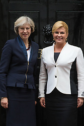 Downing Street, London, October 11th 2016. British Prime Minister Theresa May welcomes Croatian President Kolinda Grabar-Kitarović to her official residence.