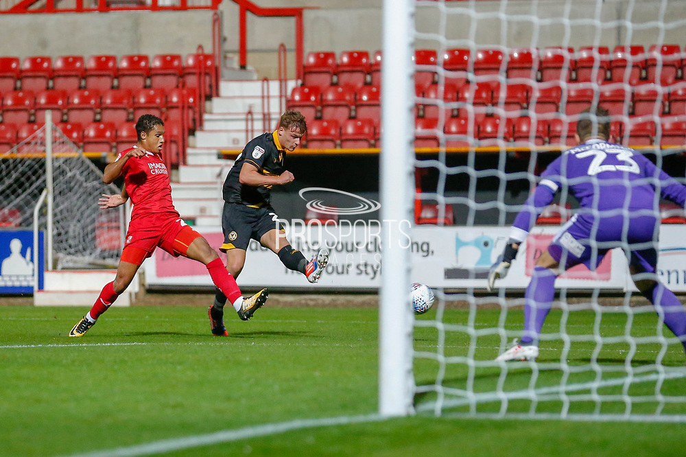 Newport County defender David Pipe (2) shoots towards goal during the EFL Trophy Group Stage match between Swindon Town and Newport County at the County Ground, Swindon, England on 11 September 2018.