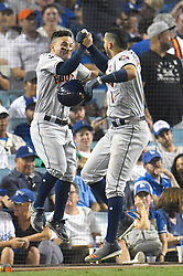 October 25, 2017 - Los Angeles, California, United States - Houston Astros second baseman JOSE ALTUYE  #27 congratulates Houston Astros shortstop CARLOS CORREA #1 on his 10th inning homer, hit just after Altuva hit one. The Los Angeles Dodgers played host to the Houston Astros in game 2 of the World Series.The Astros beat the Dodgers 7:6 in game 2 of the World Series.  (Credit Image: © John Mccopy/Los Angeles Daily News via ZUMA Wire)