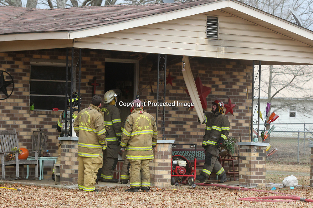Firefighters from Guntown, Pratts-Friendship and Baldwyn fire departments work after putting a fire out at a residence on Highway 370 in Baldwyn Sunday afternoon.